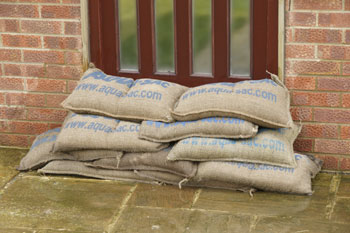 Self Filling sandbags wet and protecting a front door
