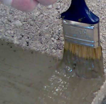 Brush on a second coat of Tanking at 90 degrees to the first, to avoid leaving 'pinholes' of weakness in your waterprrof coating.