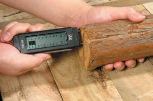 Testing wood using a Damp Meter.